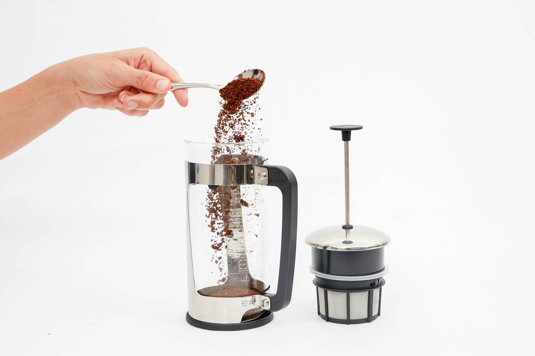 Place ground coffee in French Press